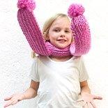 girl wearing pink pom pom scarf