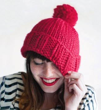 girl wearing red knit hat