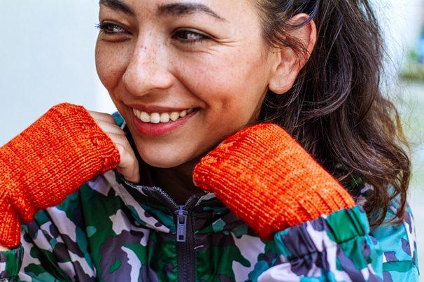 girl wearing orange fingerless gloves