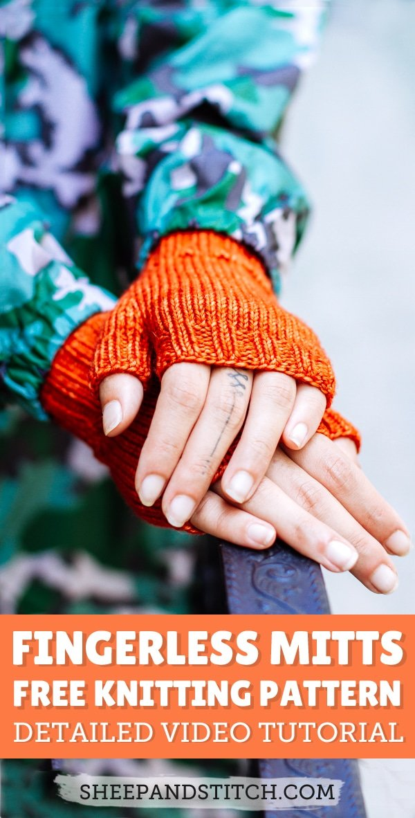 A pair of orange fingerless mittens