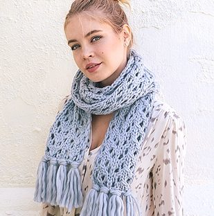 girl wearing blue knit scarf