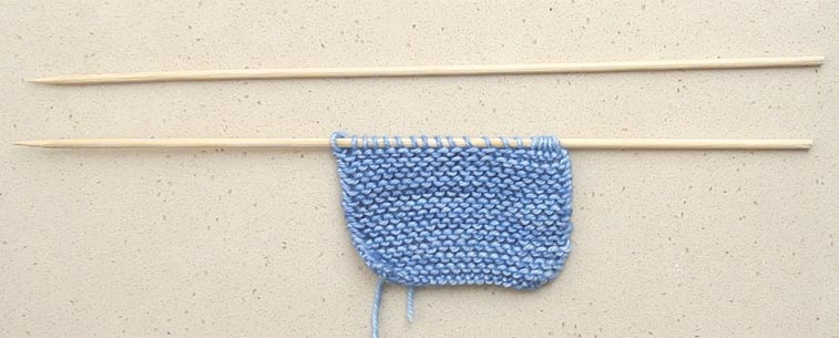 knitting with kebab skewers to save money